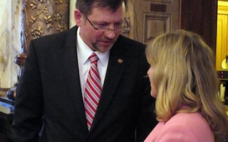 Kansas Senate Majority Leader Terry Bruce, left, a Nickerson Republican, consults with Sen. Elaine Bowers, a Concordia Republican, during the chamber's session, Wednesday, Feb. 25, 2015, at the Statehouse in Topeka, Kan. Bruce and Bowers are sponsors of a bill to end a requirement for people to obtain a permit to carry concealed weapons. JOHN HANNA — AP Photo